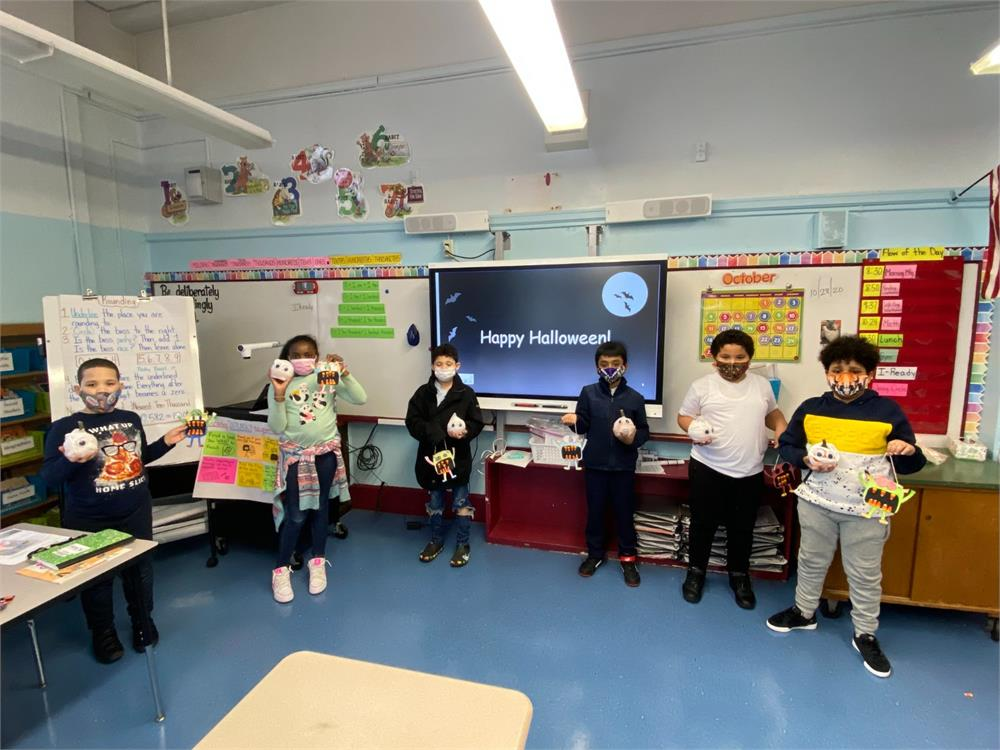 Socially Distanced Students Show off Their Scary Monster and Pumpkin Making Projects at PS 59