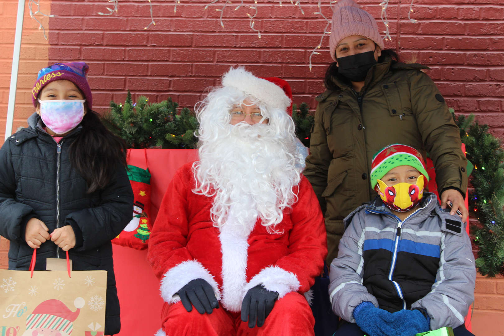 A family taking a picture with Santa.