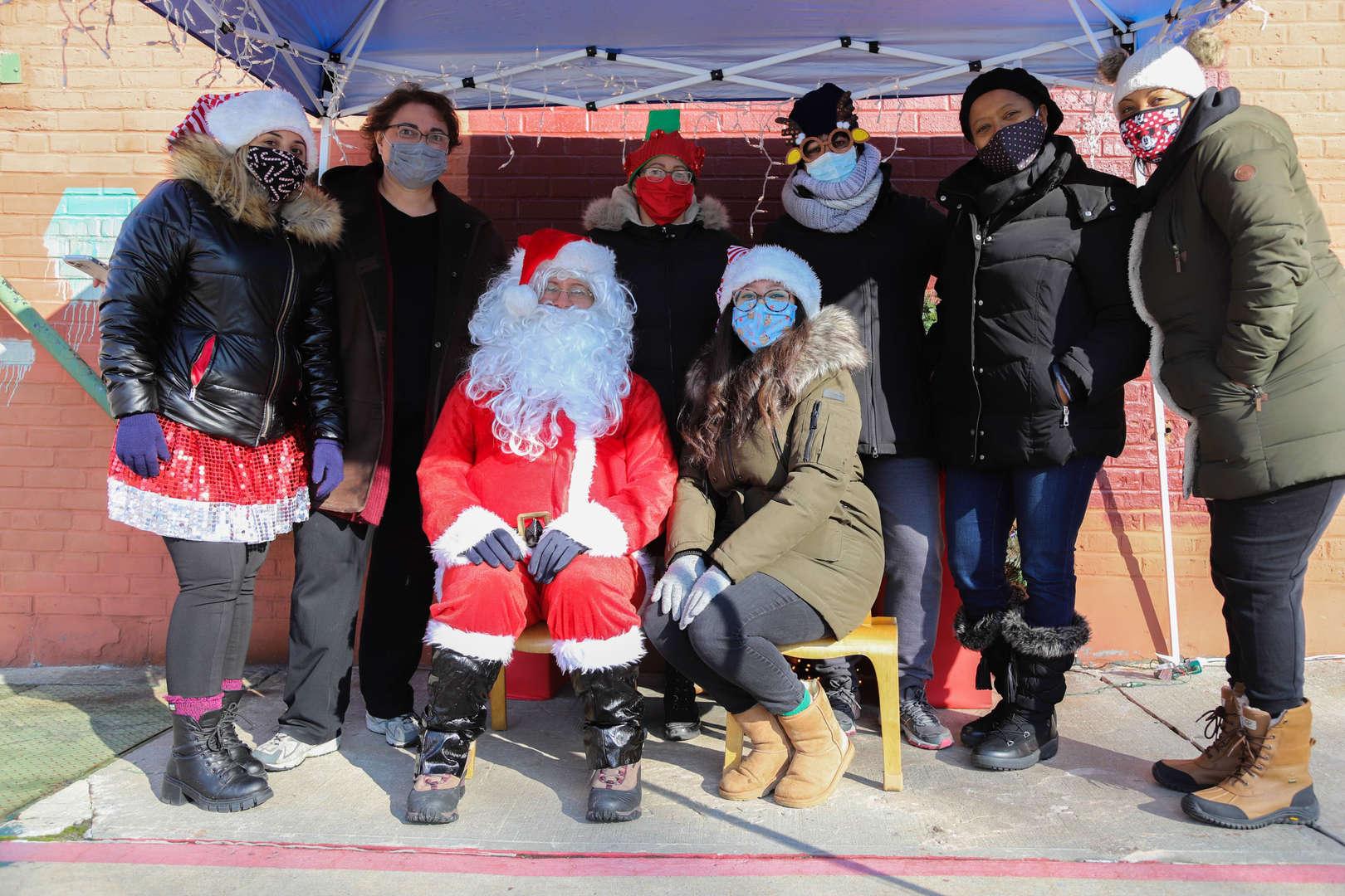 ps 59 staff posing with santa