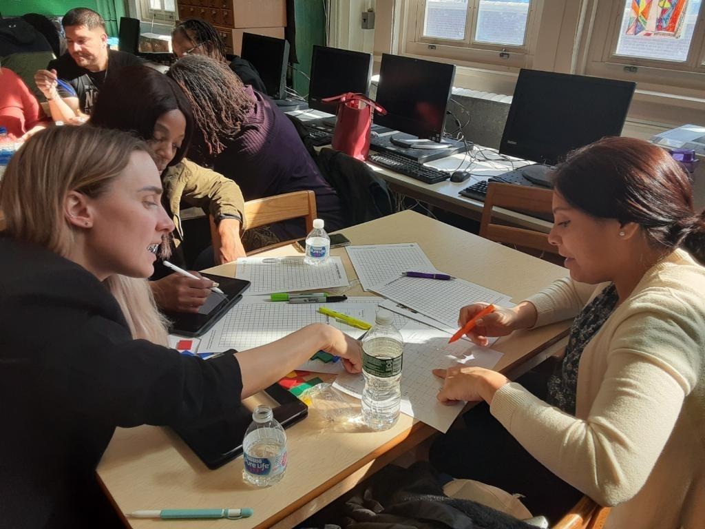 Women work on worksheets together