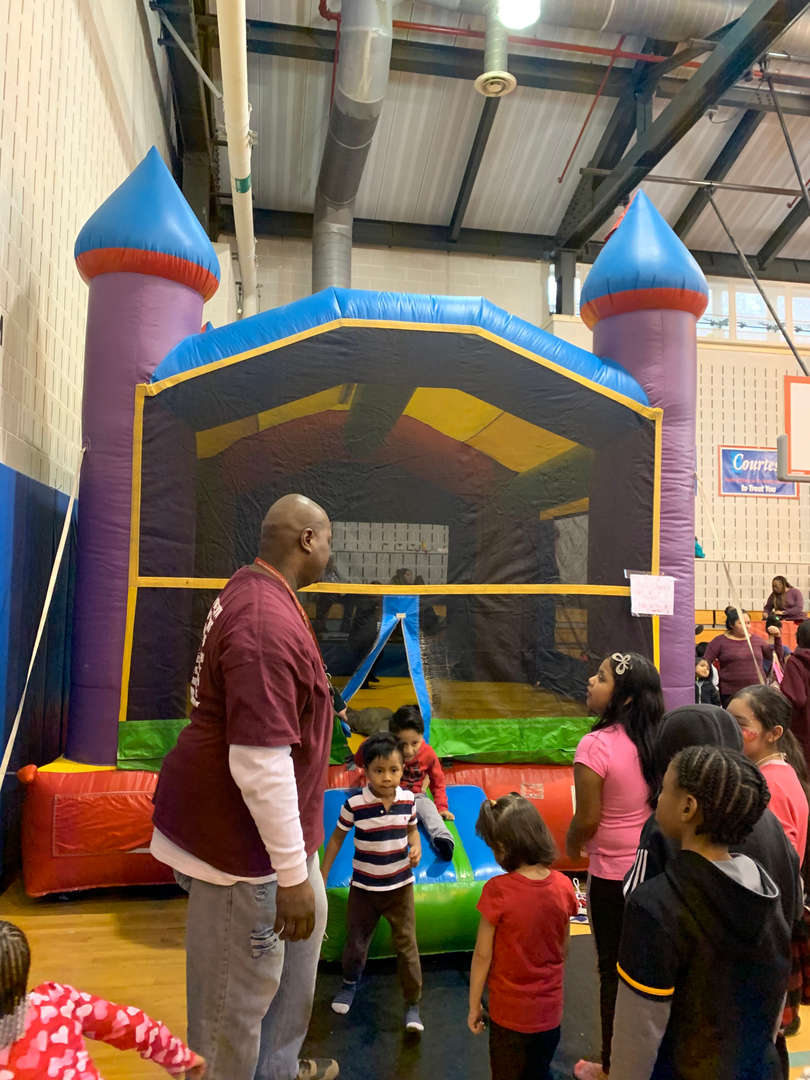 A huge inflatable bouncy castle in the gymnasium