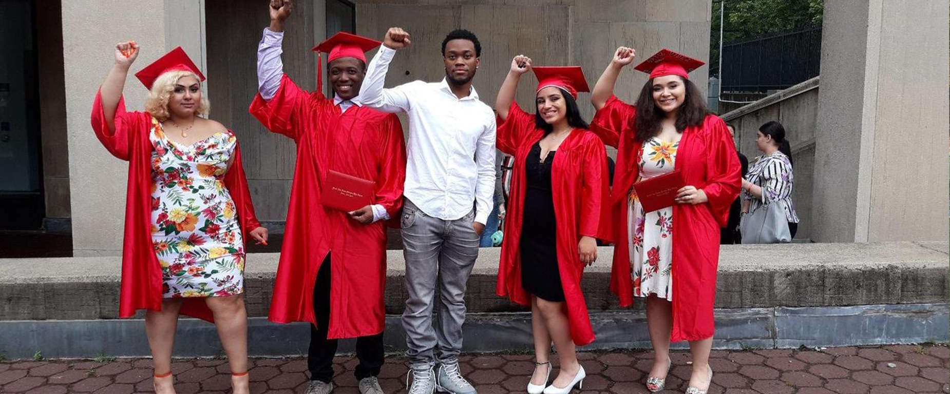 A group of graduating seniors in red cap and gowns