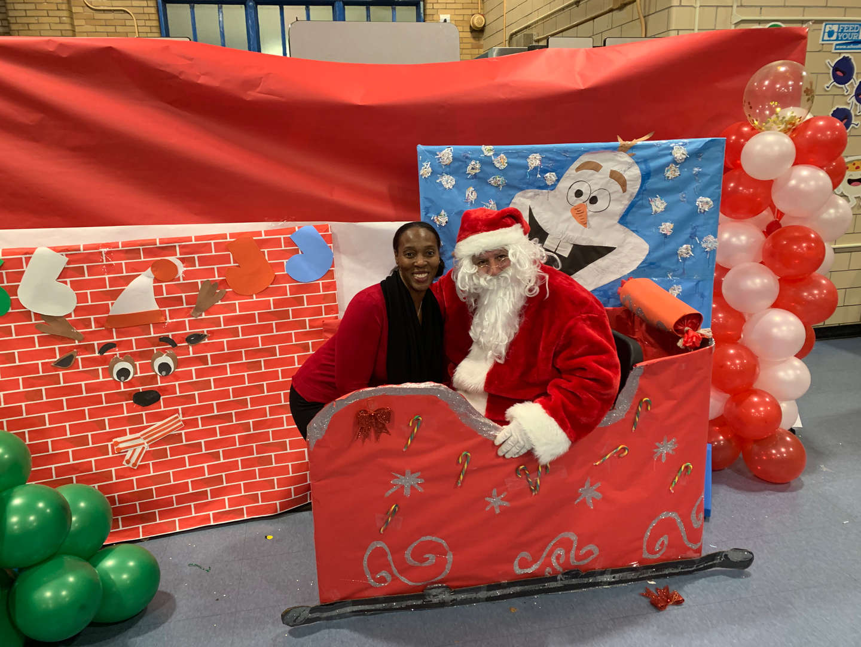A woman poses with Santa
