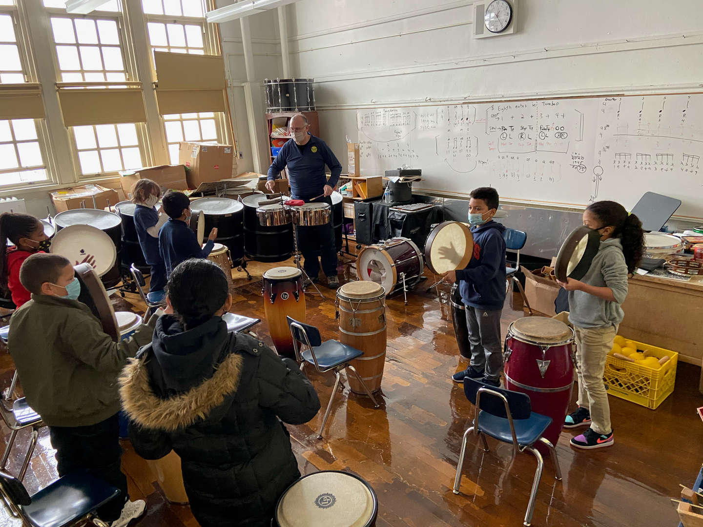 Students standing playing percussion instruments