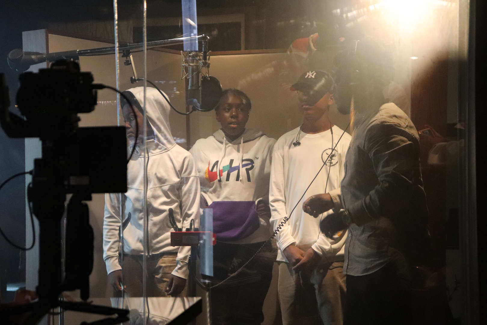 Four students singing in the studio