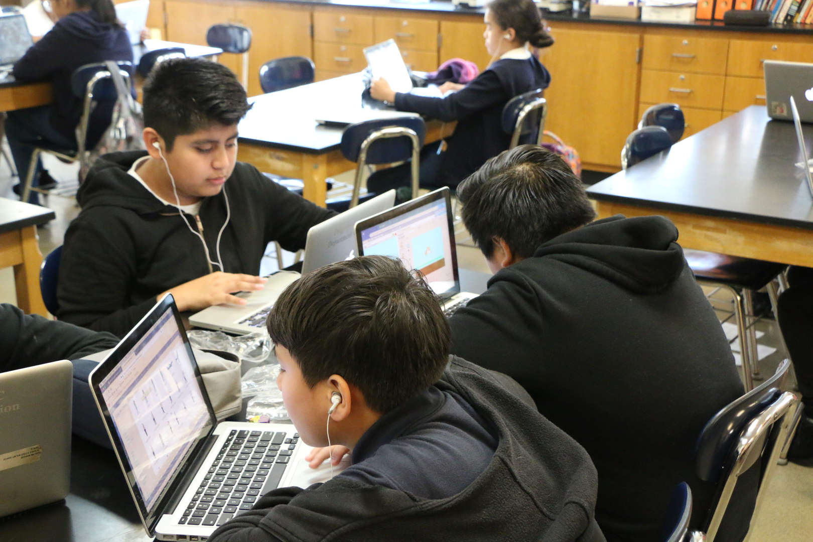 Students work on their laptops in class