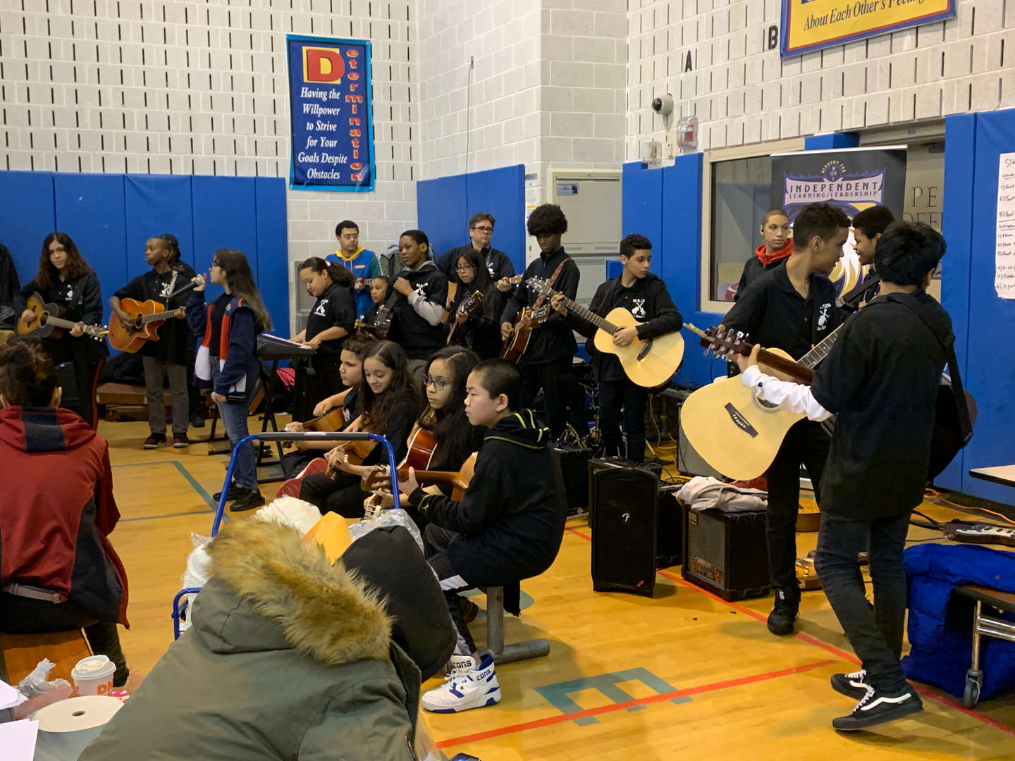 Students playing instruments in the gymnasium
