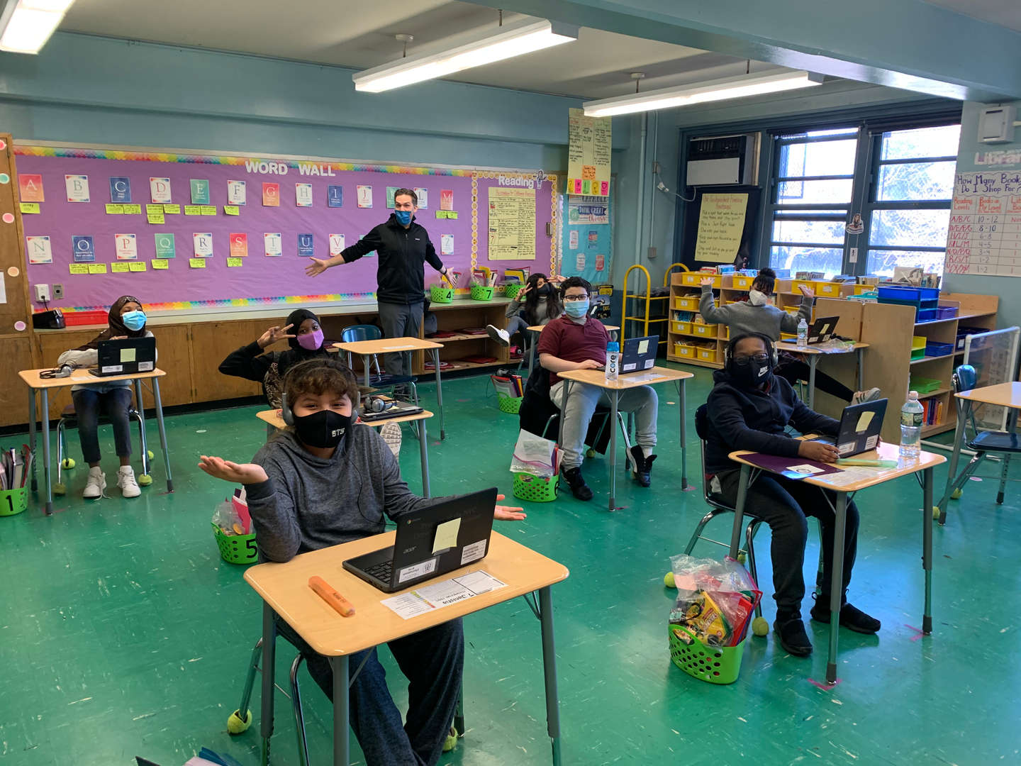 Students sitting at their desks with masks on during class