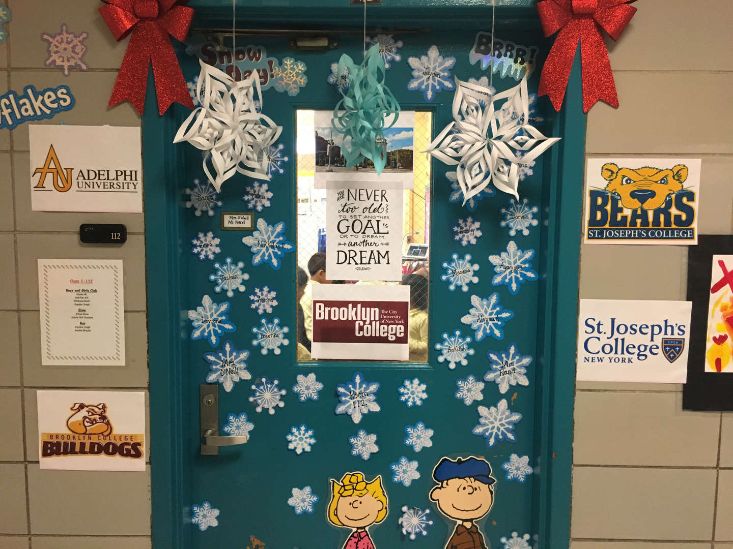 A door decorated with snowflakes and Charlie Brown decals