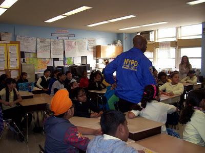 A NYPD school officer walks through a classroom