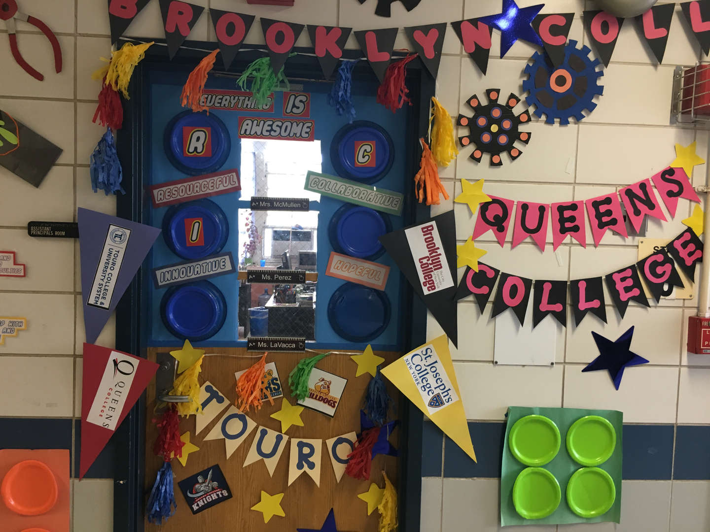 Colorful paper flags and plats decorating a door and wall