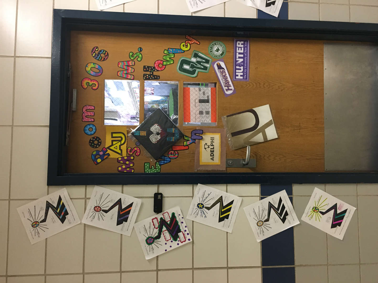 Door of Room 306 decked out with college stickers