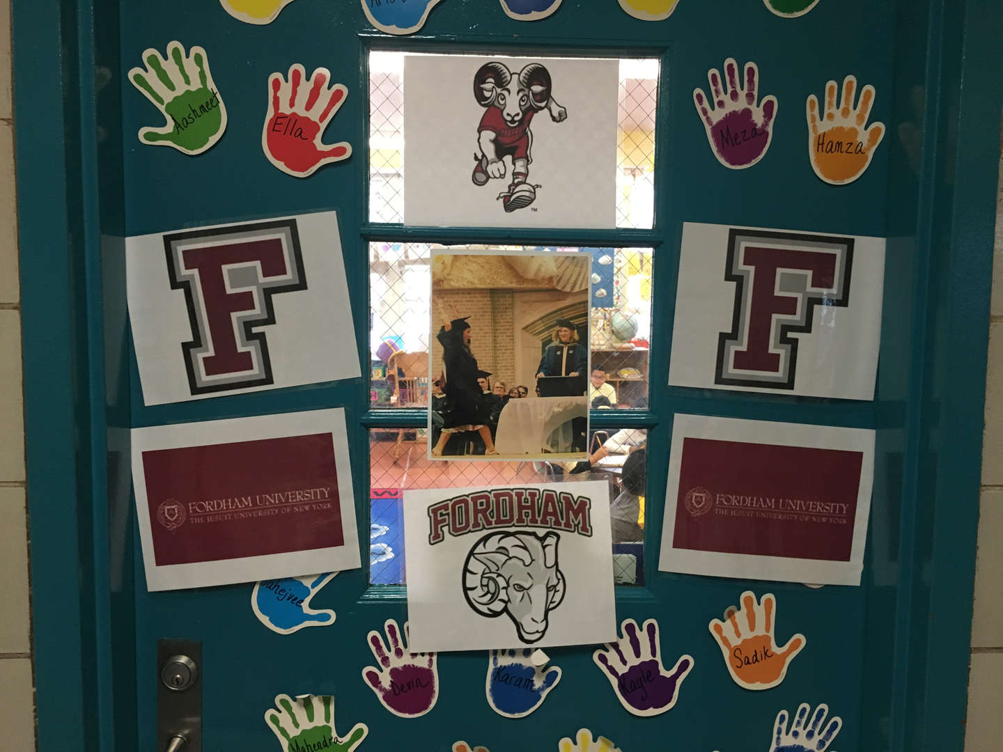 Fordham University logo and lettermark decorating a door