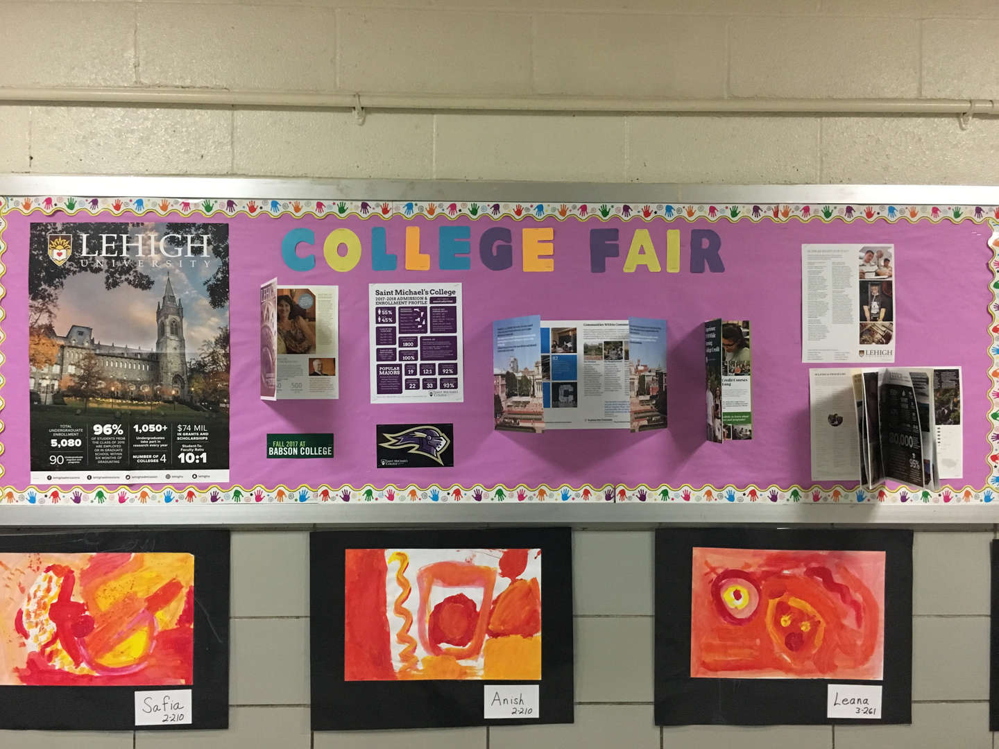 A colorful College Fair bulletin board with brochures and informational packets stapled to it