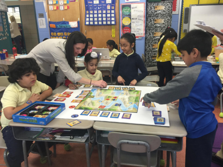 Teacher helping students with a class activity
