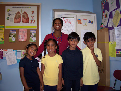 The nurse with four students in her office