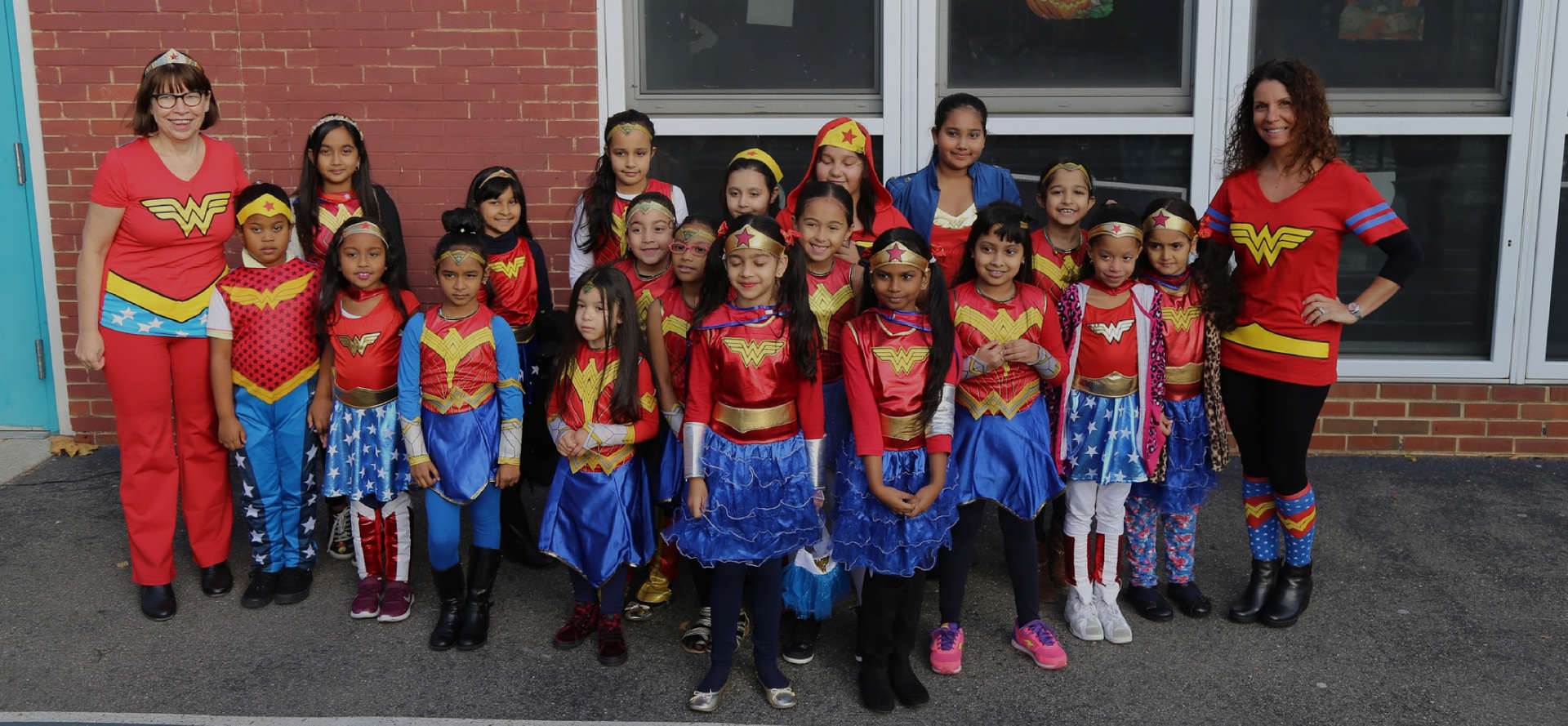 Students and two faculty members dressed in Wonder Woman outfits