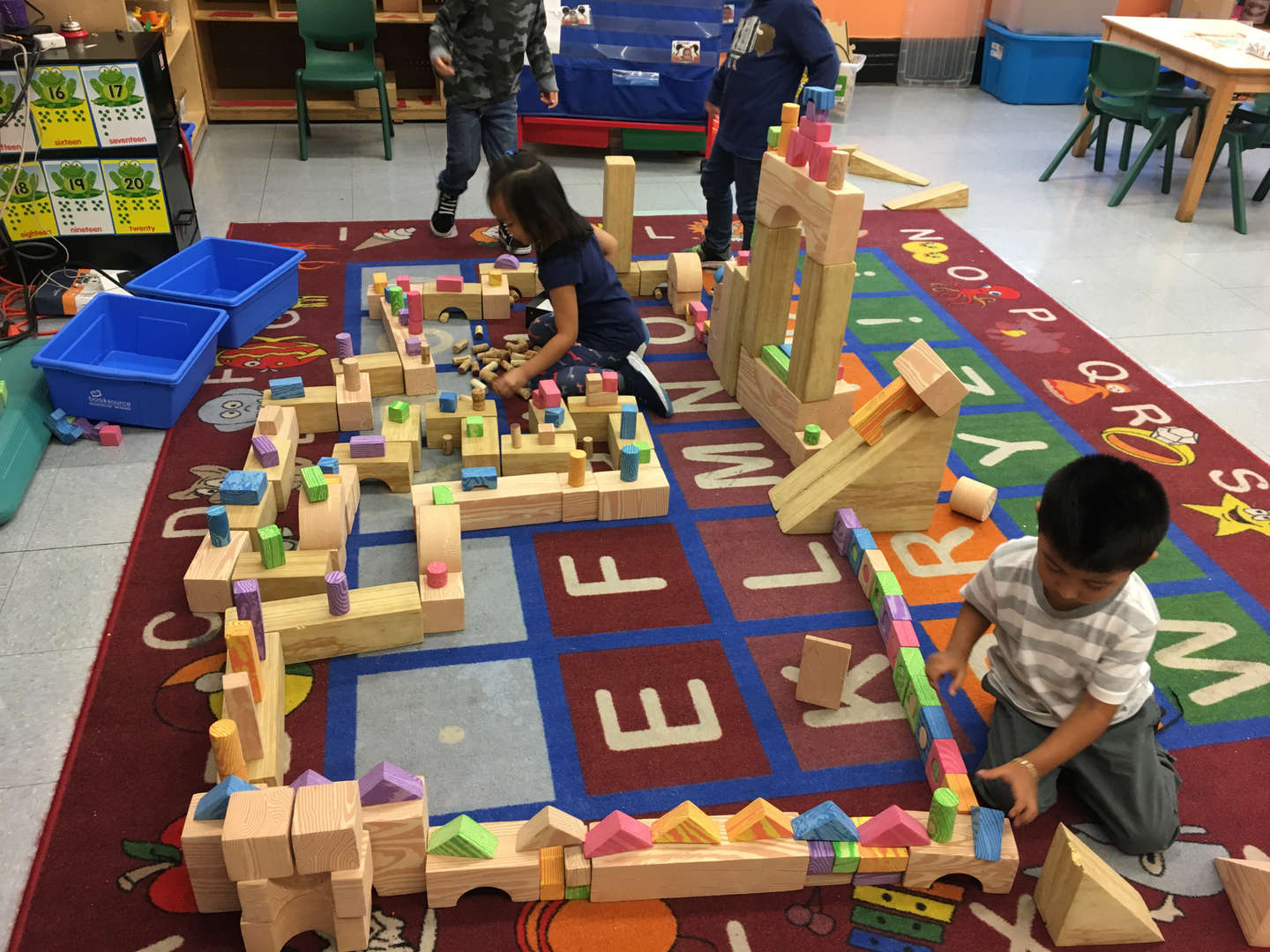 Students play with building blocks