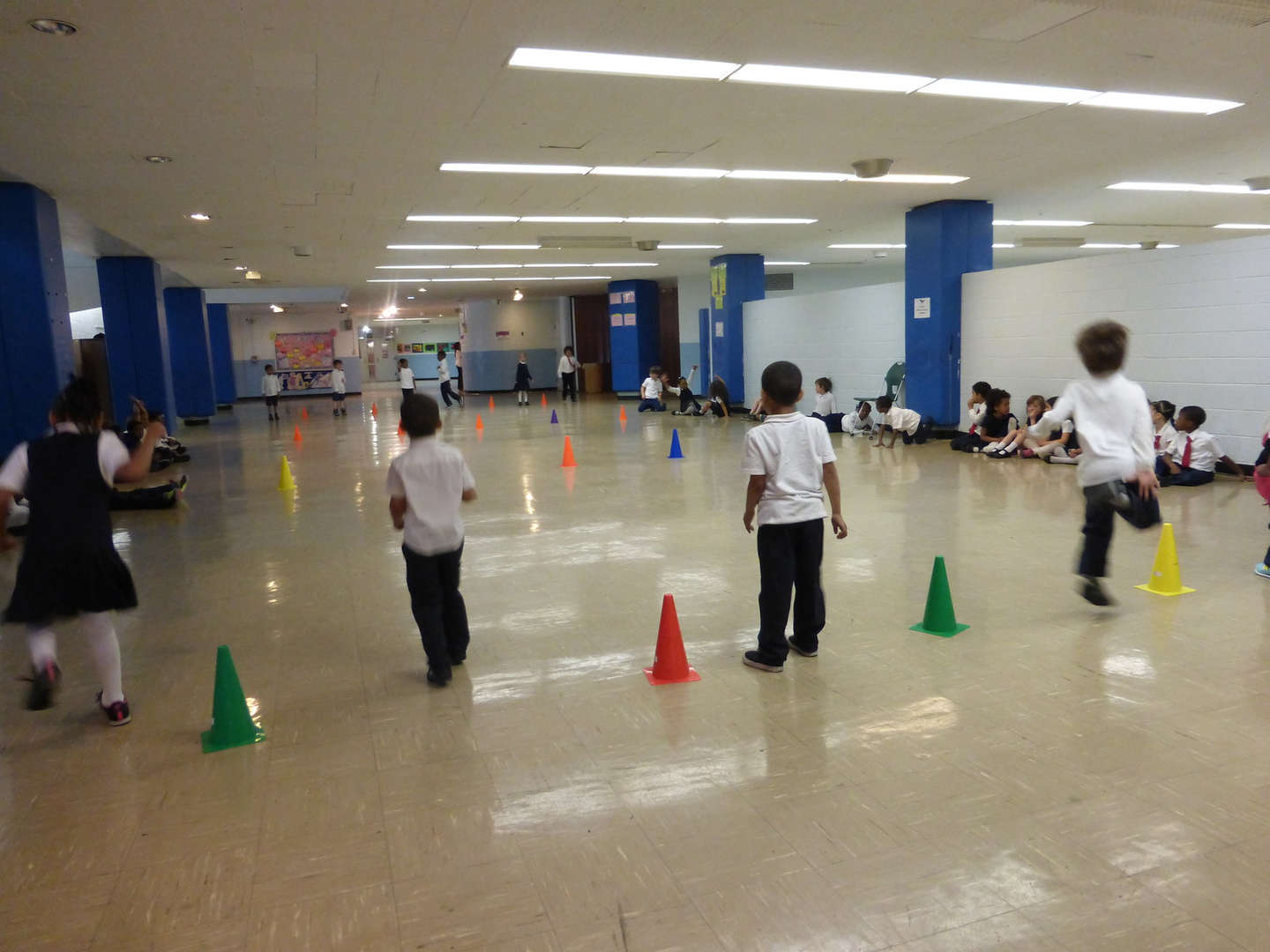 Students play a game using colorful cones