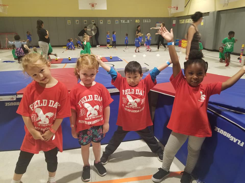 Students wearing red Field Day shirts