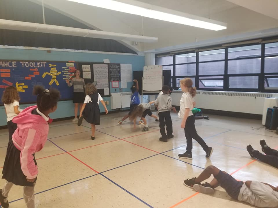 Students stretch during P.E.