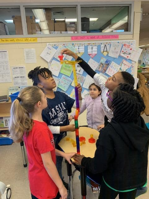 Students build a tall tower