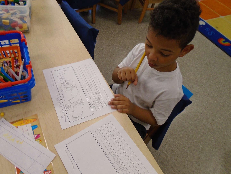 Boy writing a book