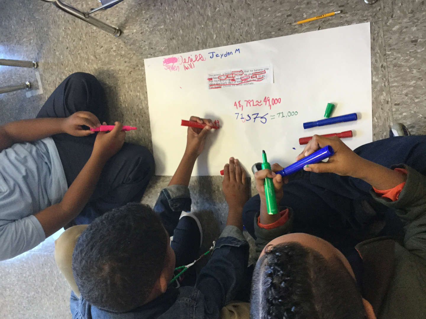 Students working together on math problem