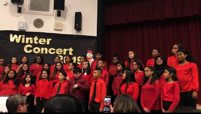 Students wearing red perform for the winter concert