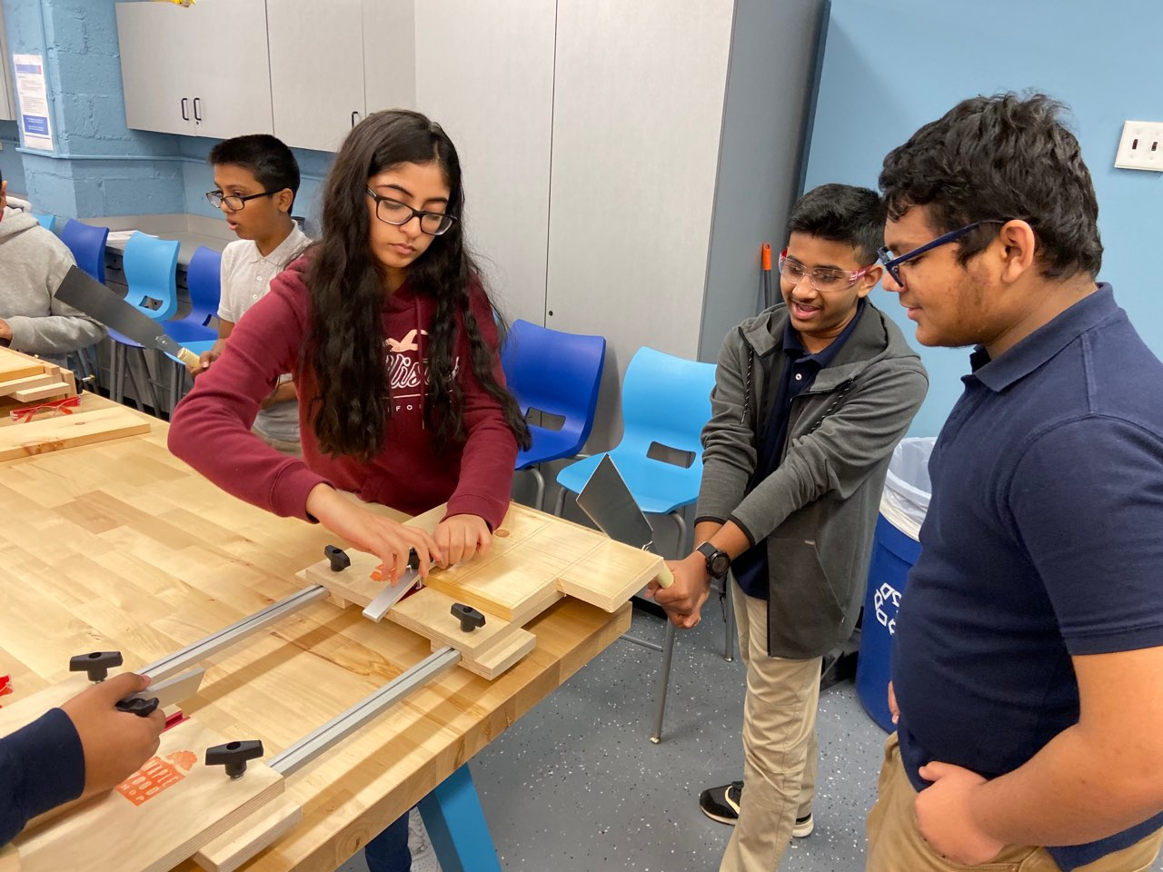 Students use the design lab at the maker space at Thomas Edison HS during Computer Science Ed week
