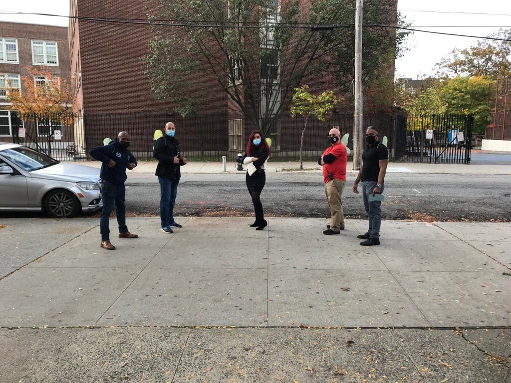 Teachers wearing masks on sidewalk