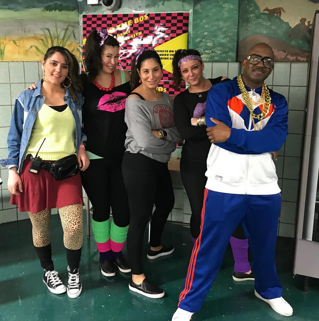 Teachers dressed as 70s characters