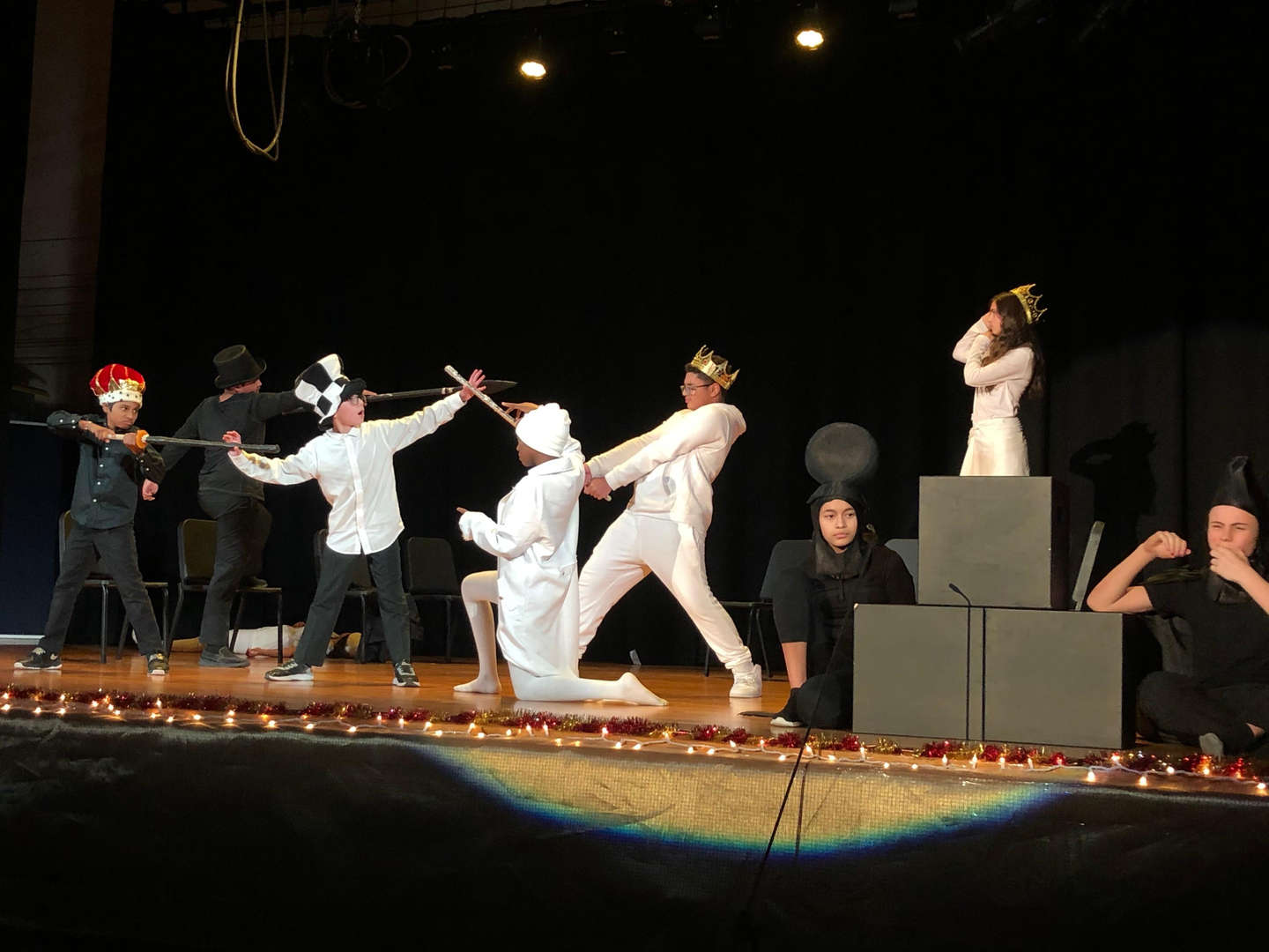 Students performing play on stage