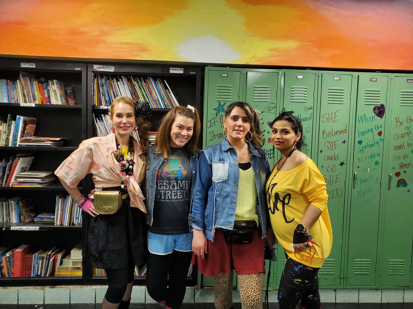 Teachers wearing decades costumes