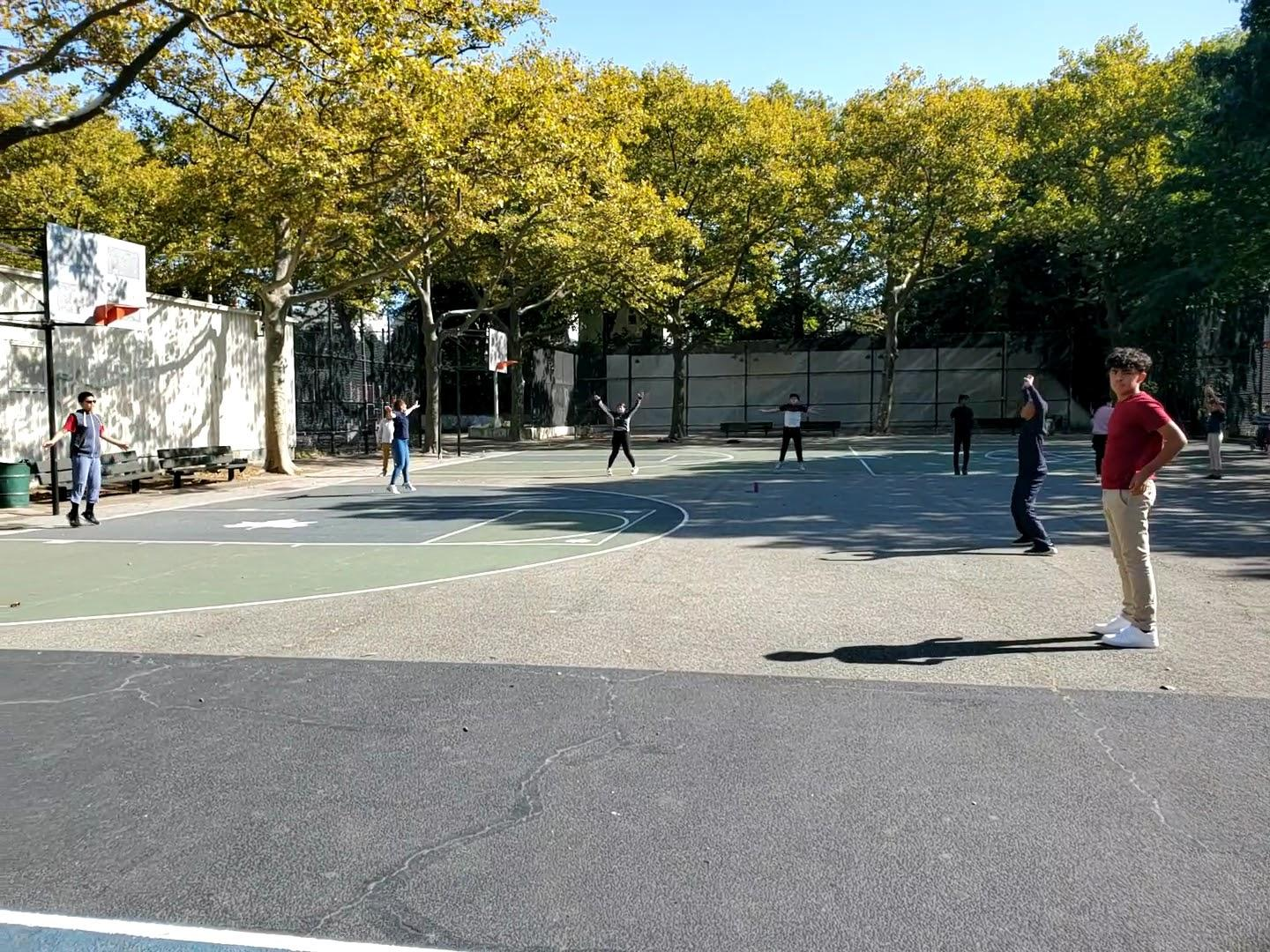 Students exercise on basketball court