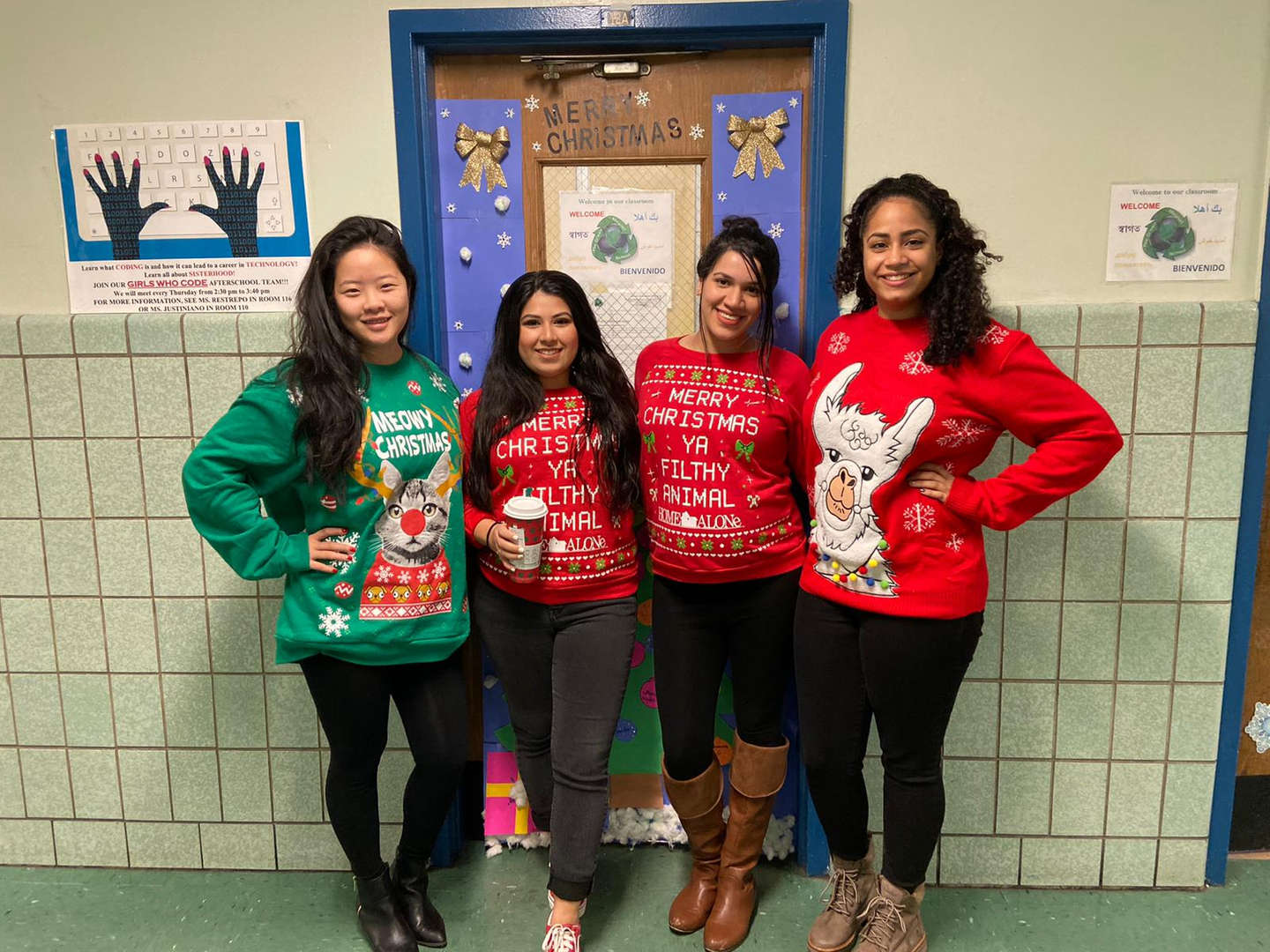 Teachers wearing Christmas sweaters