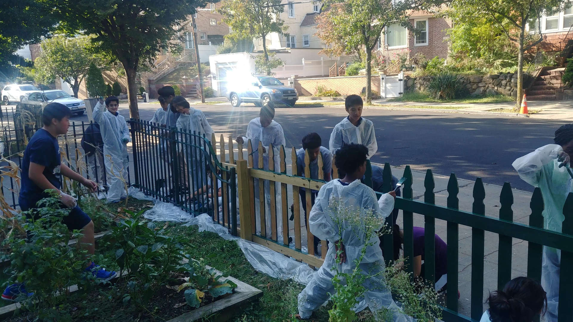 Students volunteer clean the garden