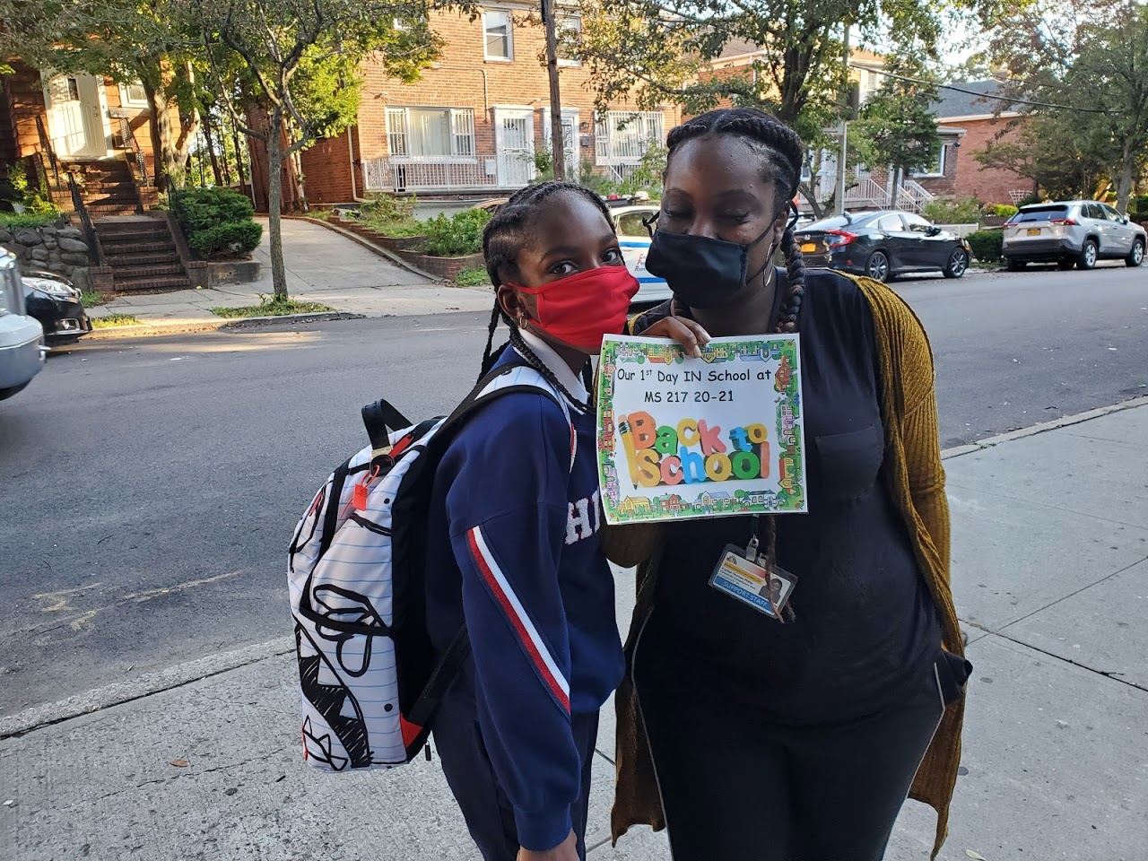 Mother and daughter wearing masks during the first day back to school