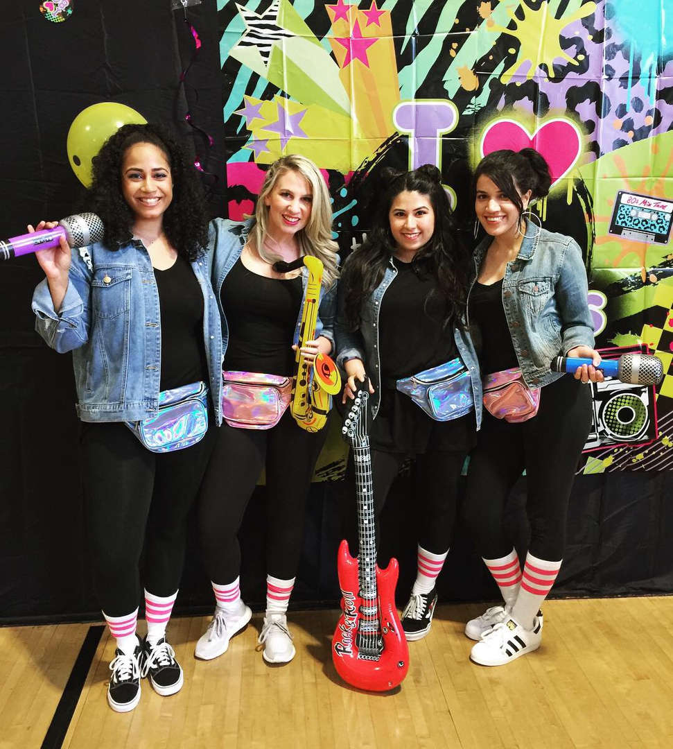 Teachers wear rock n roll costumes