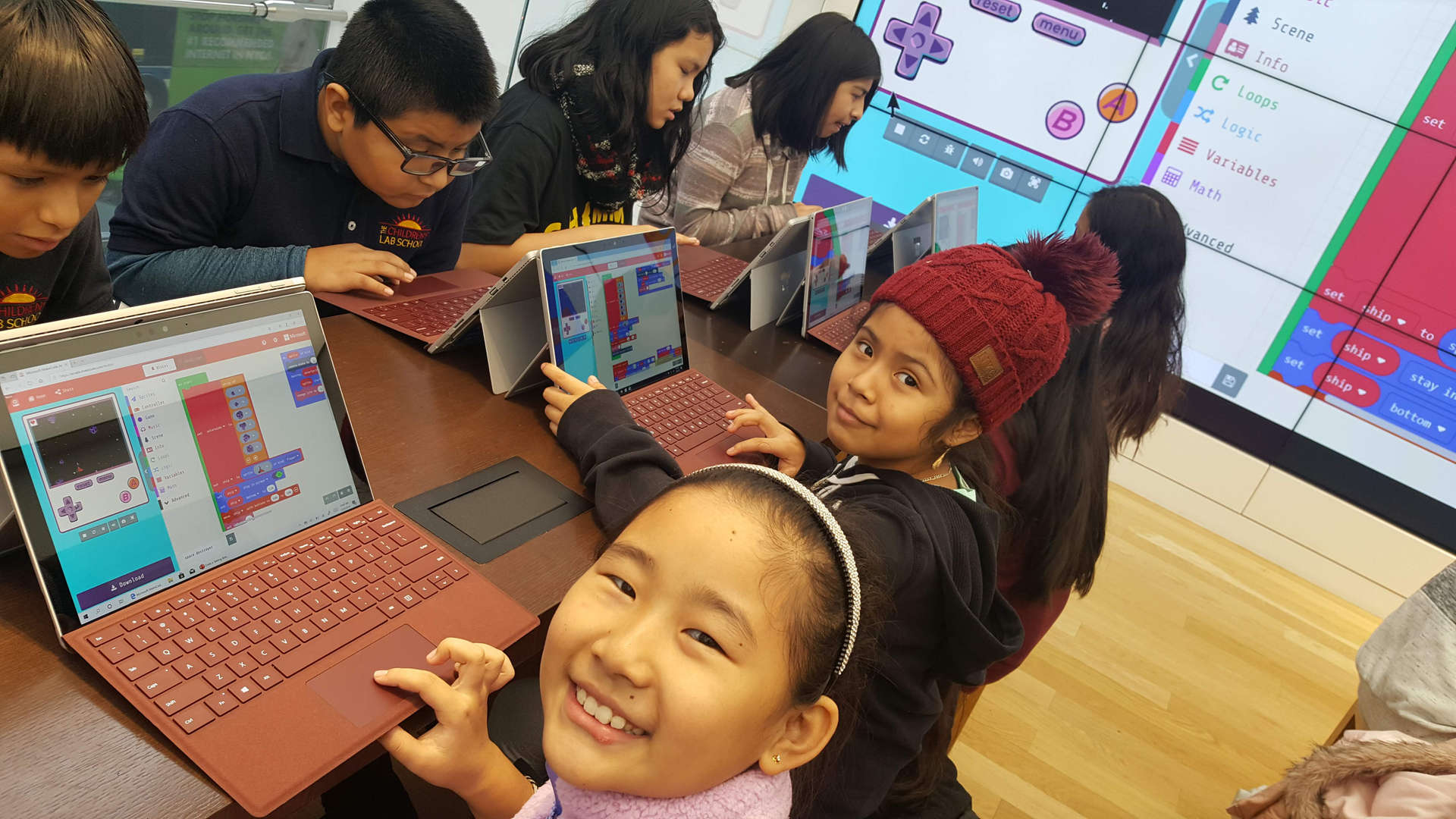 Students coding on tablets