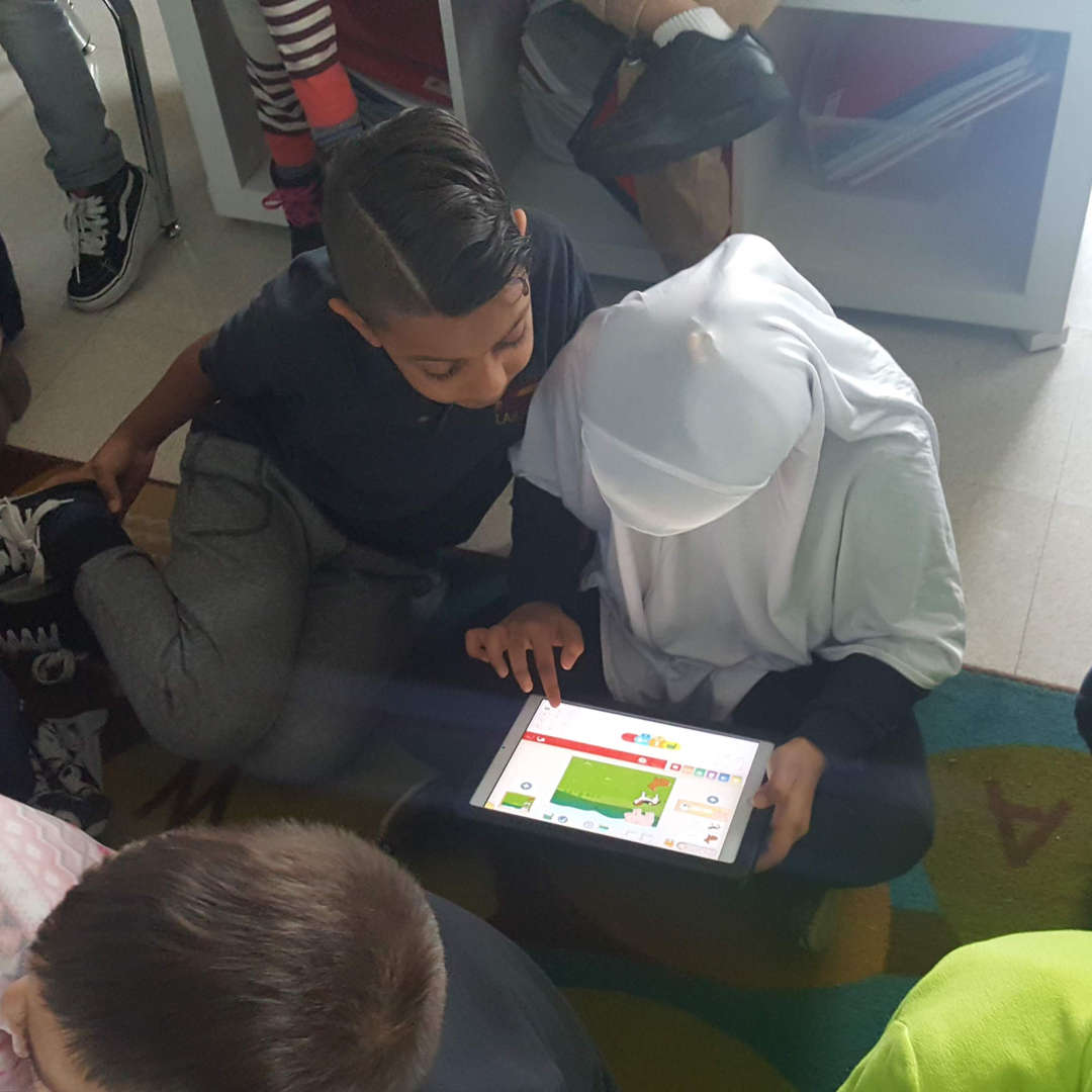 Two students collaborating on an iPad