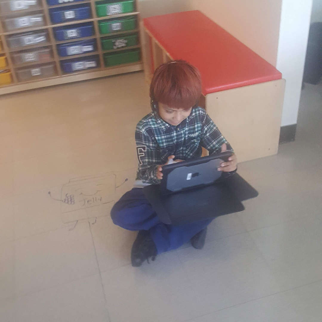 Student working on an iPad