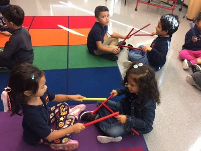 Students play with music instruments