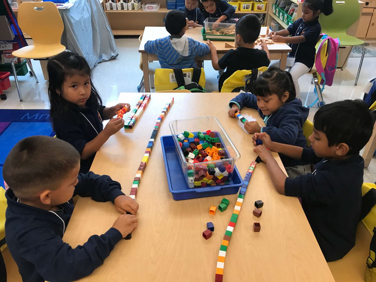 Students playing with Legos