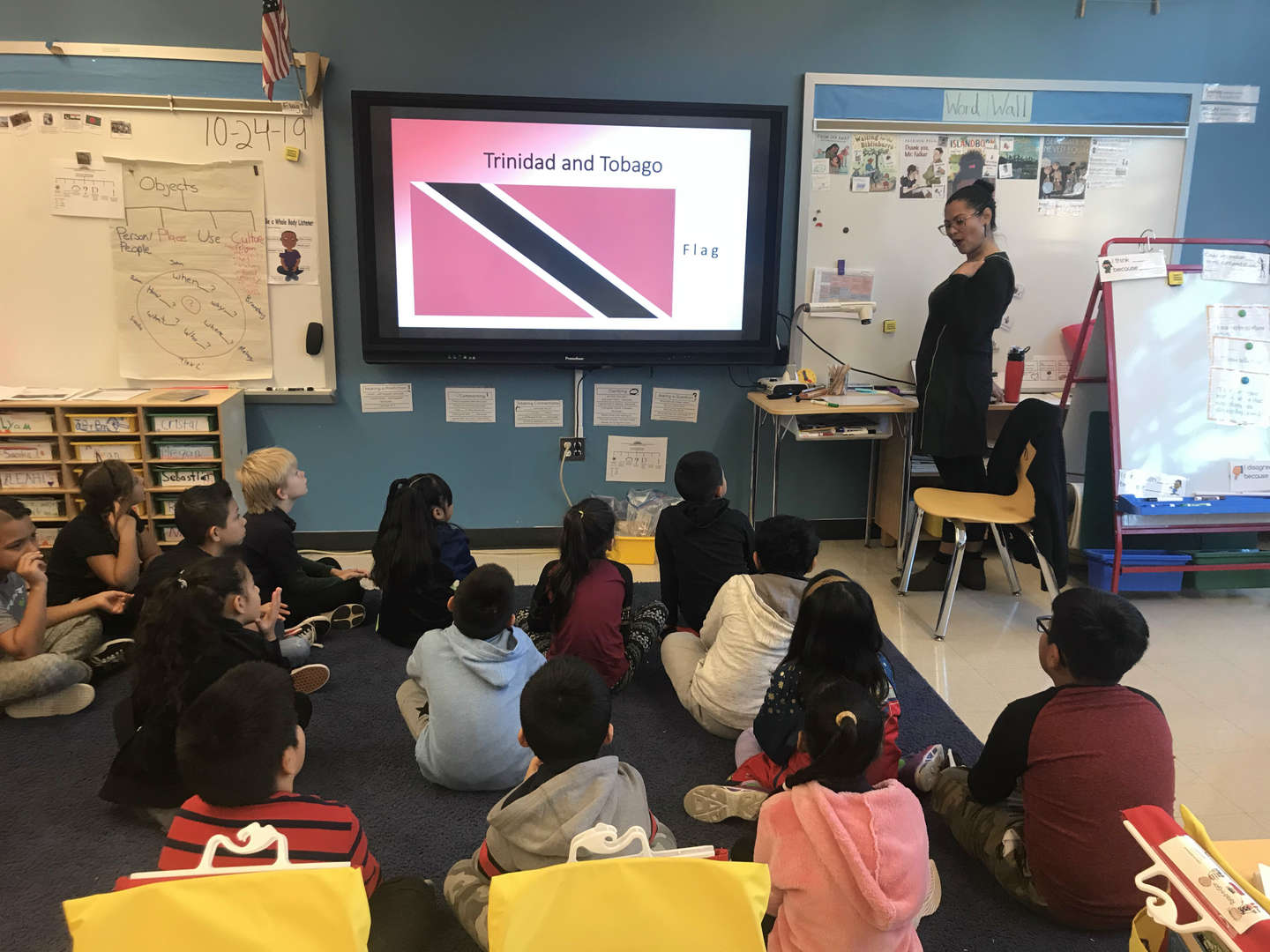 Students learning about the flag of Trinidad and Tobego