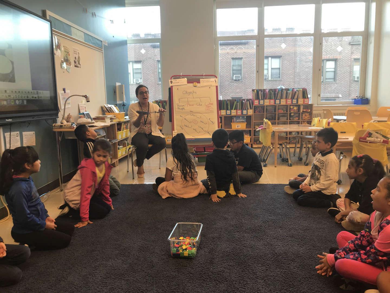 Students listening to Assistant Principal Ms. Jennifer Velasco