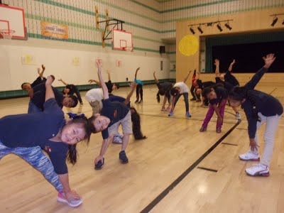 Students stretch during P.E. class