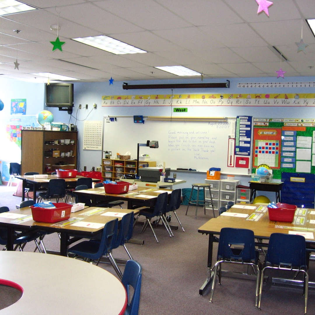 Classroom with whiteboard and grouped desks