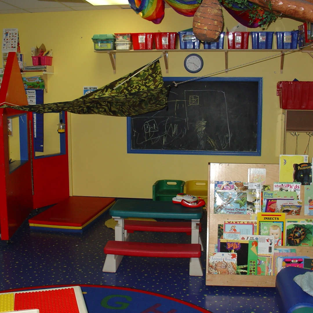 Colorful classroom with chalkboard, small table and books