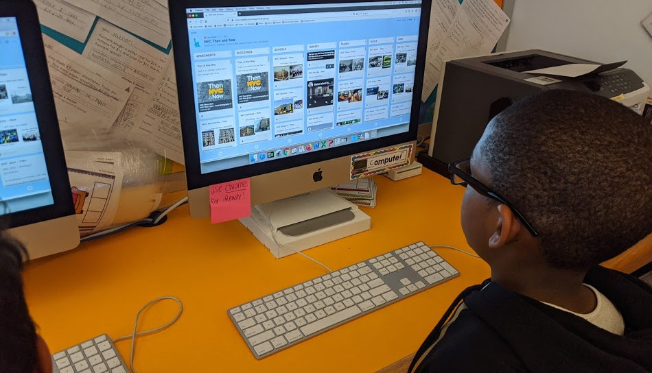 Students works through the NYC DOE Passport to Social Studies Core Curriculum on the computer